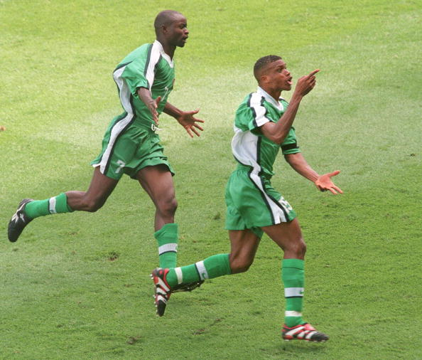 NANTES, FRANCE - JUNE 13:  Nigerian midfield Sunday Oliseh (R) jubilates after he scored the third and winning goal for his team 13 June at the La Beaujoire stadium in Nantes during the 1998 Soccer World Cup Group D match between Spain and Nigeria. Nigeria won 3 to 2. (at L Nigerian midfielder Finidi) (ELECTRONIC IMAGE) AFP PHOTO FRANK PERRY  (Photo credit should read FRANK PERRY/AFP/Getty Images)